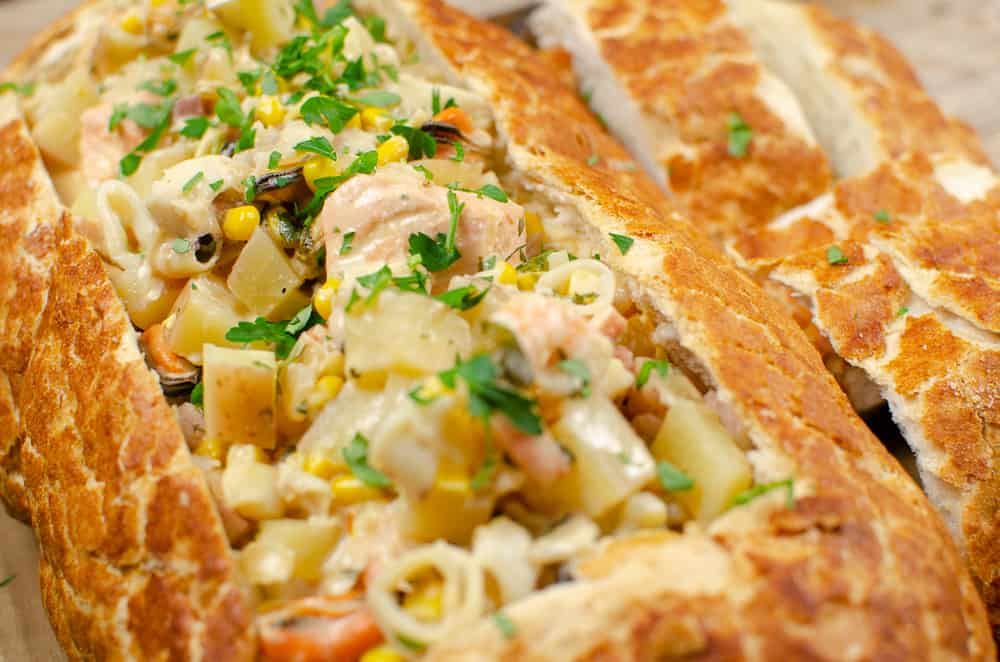 Flawless Fish chowder Bread Boat  ready to be served with chopped coriander on top
