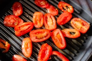 Tomatoes cooking on our griddle