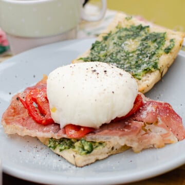Italian Styled Eggs Benedict served on a blue plate
