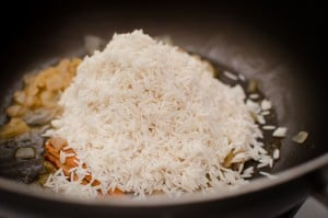White rice added to the black pan