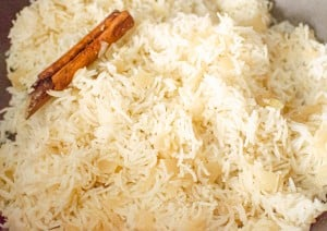 Onion Basmati Rice cooking with a cinnamon stick