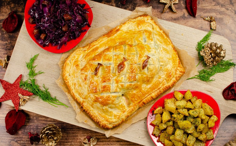 Salmon en croute served with red cabbage and potatoes