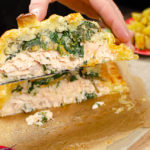 Salmon en croute been cut and lifted to be served up to eat