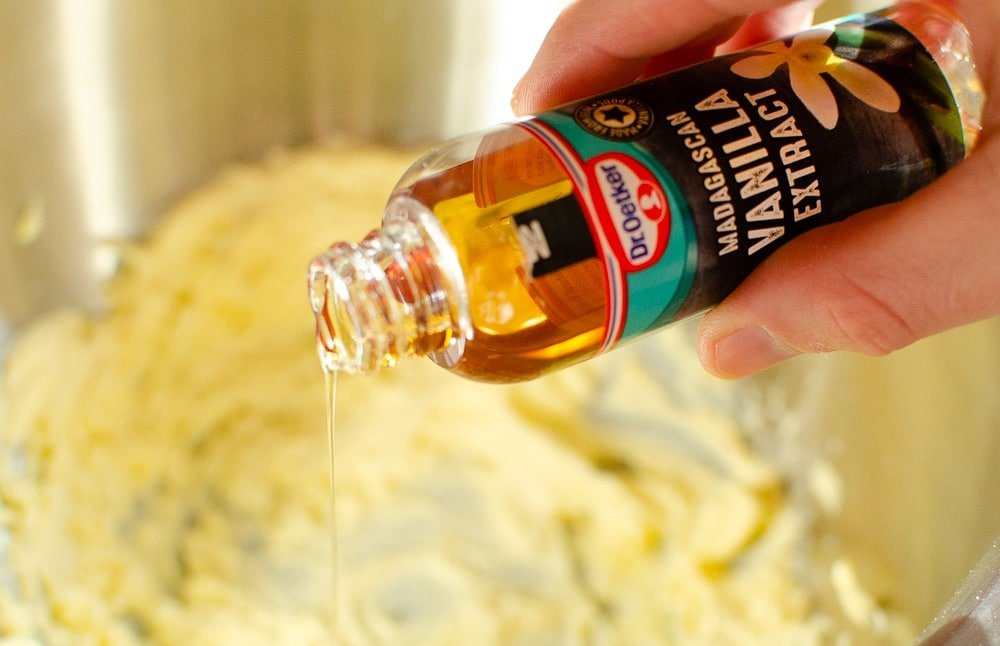 vanilla extract being poured into biscuit mix
