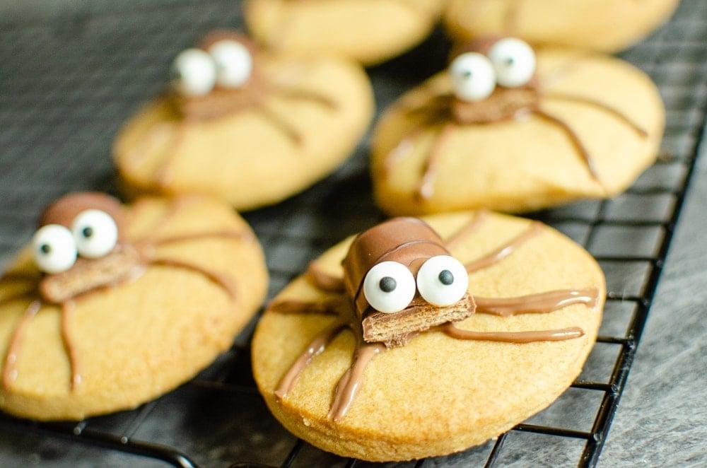 Cute Spider Halloween Biscuit's on marble worktop using kinder bueno