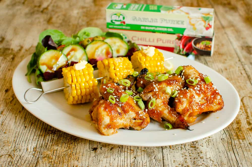 Honey Garlic Chicken Wings served with corn on cob and salad. Gia Garlic Puree & Gia Chilli Puree