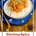 Pin image of our Sizzling Spicy Pork served with white rice in a green bowl on a blue plate with chop sticks, star anise and chopped spring onions on the side