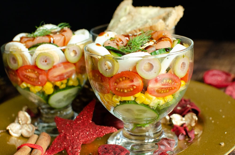 Smoked Salmon Cocktail Recipe served in glass bowls layers of cucumber, sweetcorn, tomatoes, olives, egg, smoked salmon and wholemeal bread