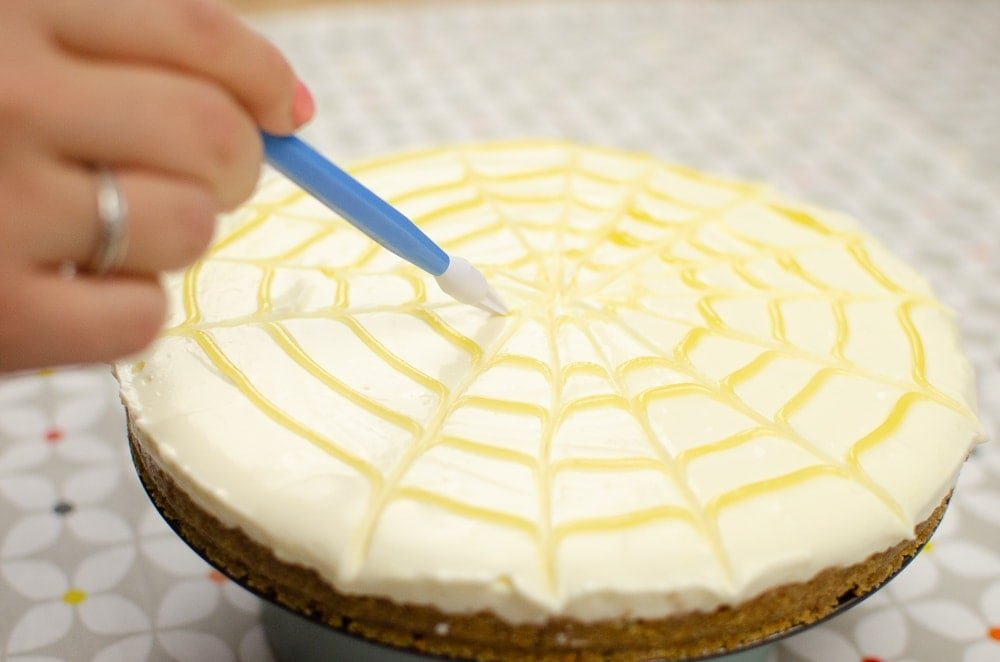 making a swirl pattern on our lemon curd cheesecake dessert