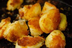 Flawless Roast Potatoes in a black baking tray