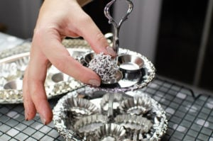 Placing our Dark chocolate truffles on a silver serving tray