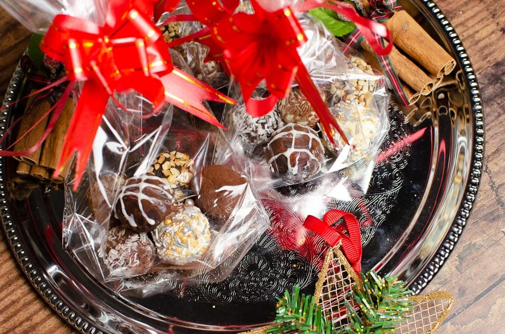 Our white chocolate truffles with other chocolate truffles served in  clear bags for Christmas gifts for family and friends.