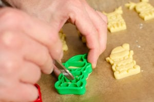 Joie christmas cutters elf in biscuit dough use fork to remove