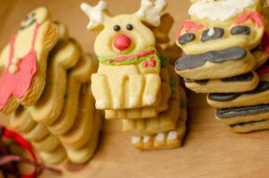 Stack of reindeer iced christmas biscuits. Xmas Cookies