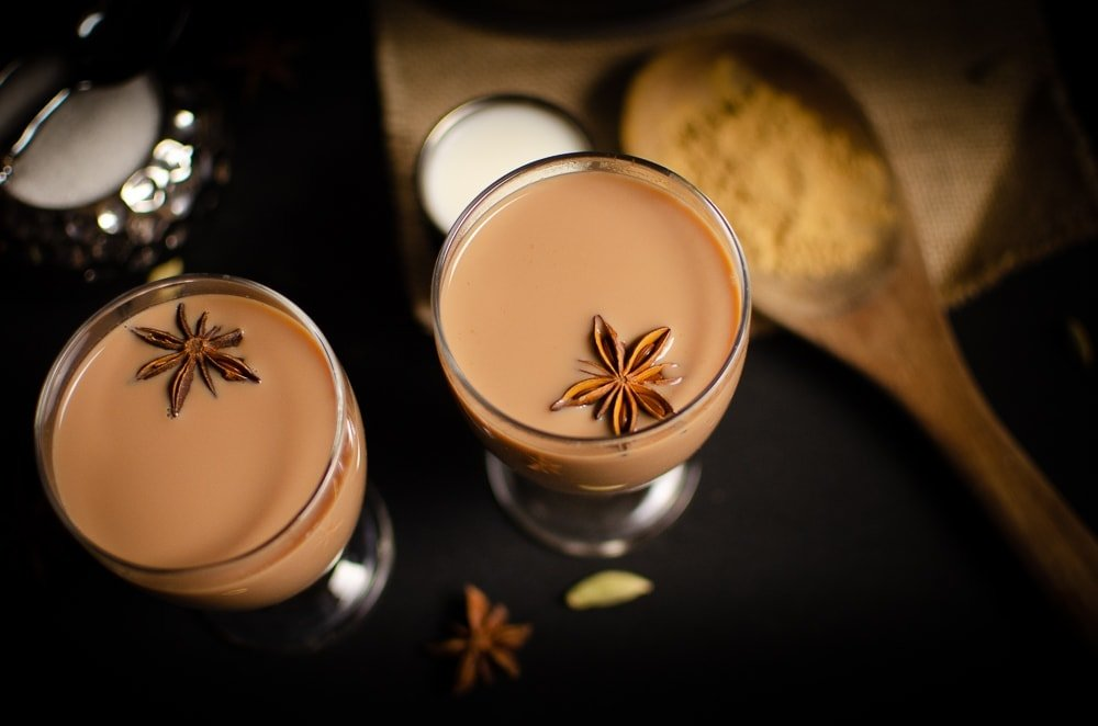 Masala tea in glasses with star anise on top