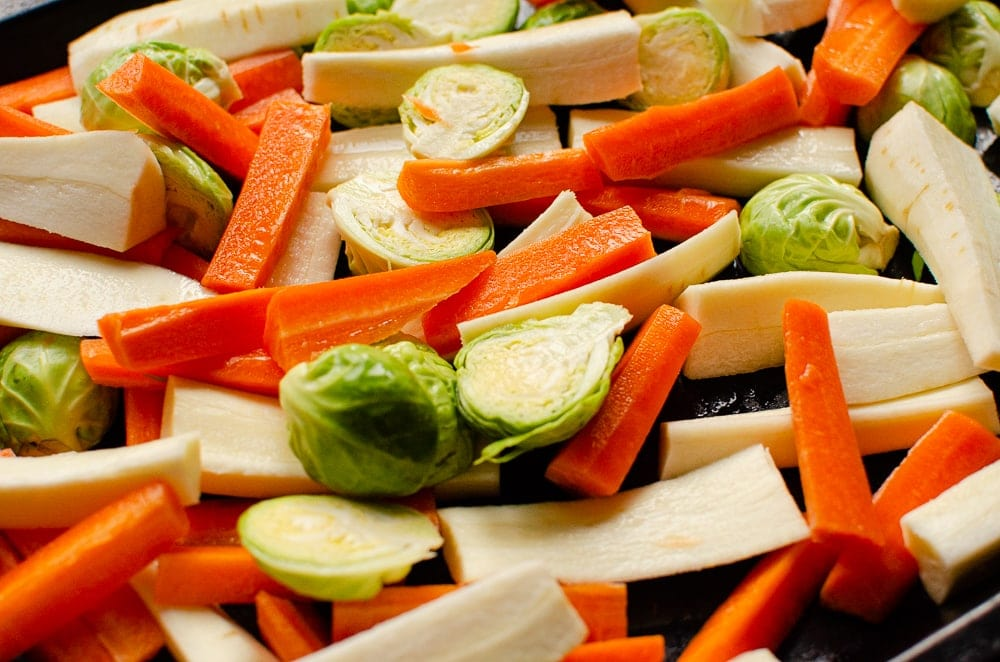 Chopped Carrots, Parsnips and Brussel Sprouts on a baking tray