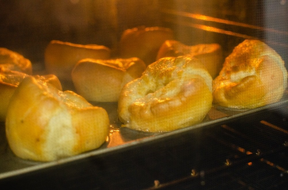 flawless yorkshire puddings cooking in the oven