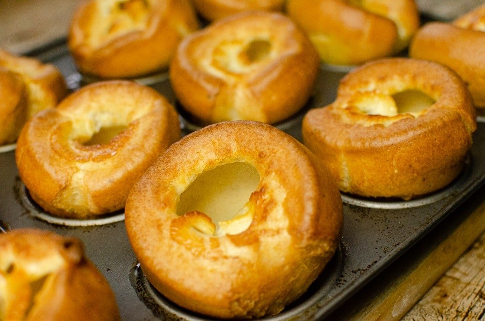 Yorkshire puddings cooling off in the cupcake tin