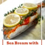 Pin image of our Sea Bream with Garlic and Chilli on a tin foil sheet with olive oil being poured over the top