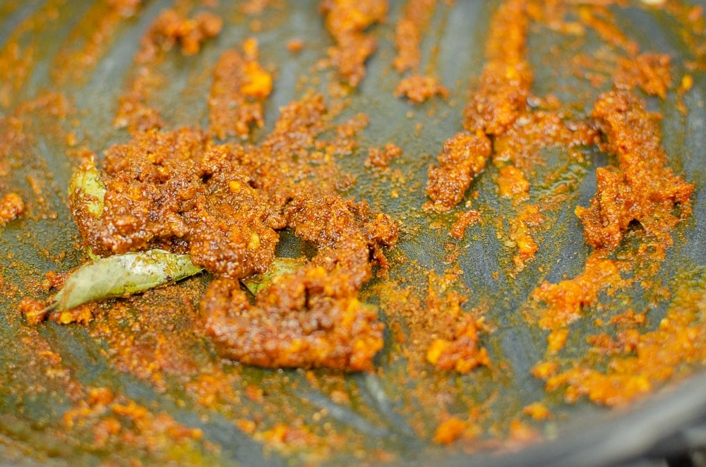 Curry Paste with curry leaves in a cast iron pan