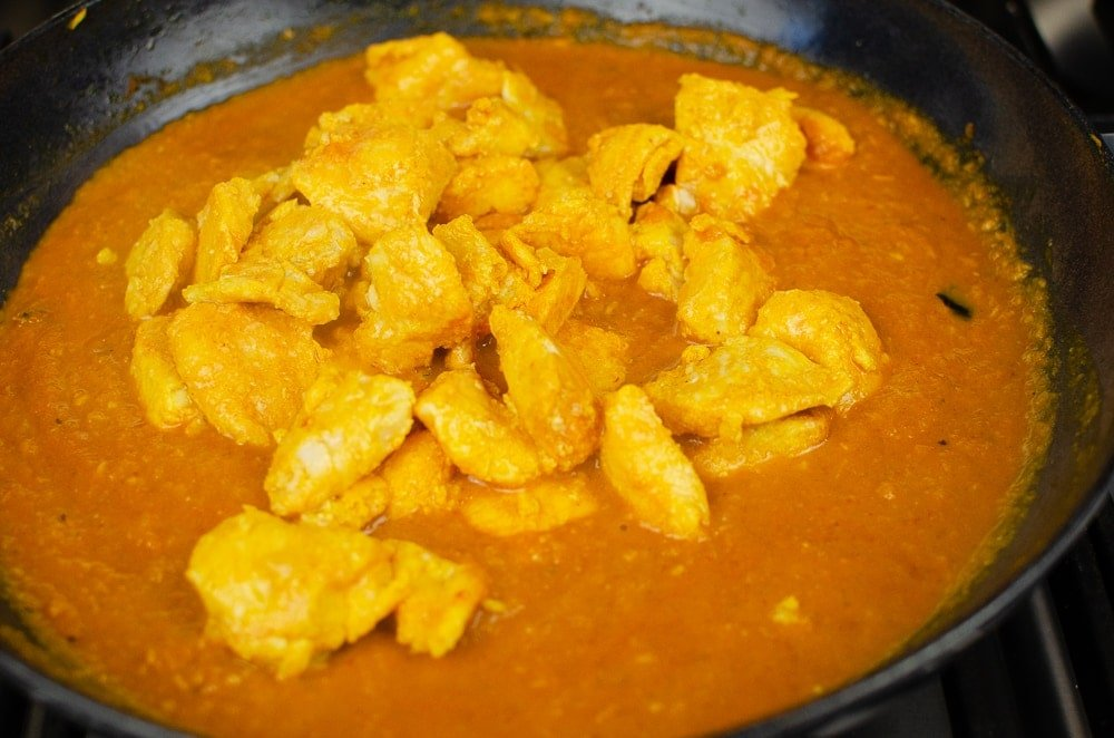 Basa Fish Curry cooking in a cast iron dish