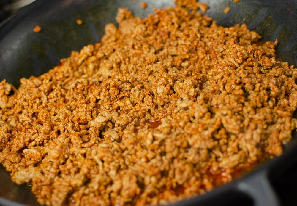 Smoked paprika and pork minced mixed together in a cast iron dish to make our pork and prawn jambalaya