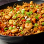 Pork and prawn Jambalaya served in a cast iron pan