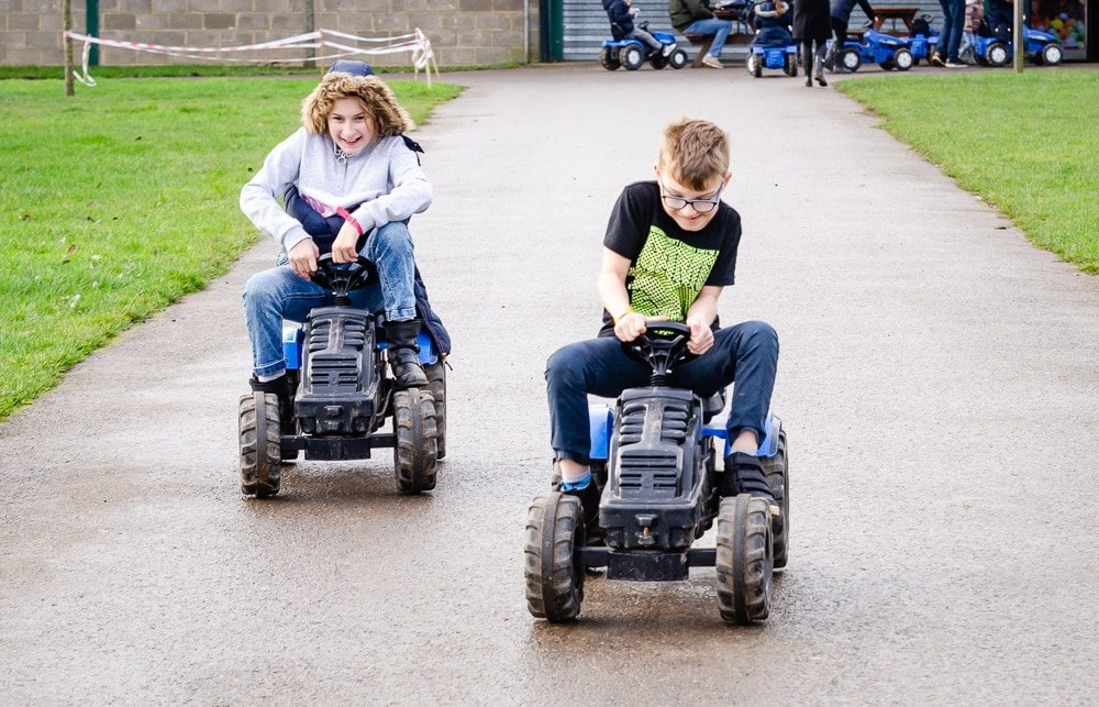 kids racing in mini tractors