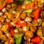 Textured Vegetable Protein mixed altogether with red and green peppers and kung pao sauce