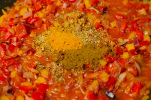 Tumeric and cumin being added to the spicy fish soup