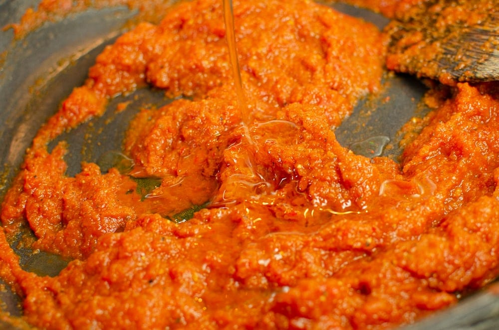 Our Kebab shop chilli sauce cooking in a cast iron dish