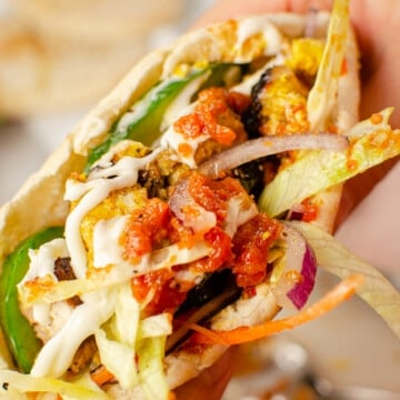 Takeaway chicken kebab recipe in a pitta bread with salad and chilli sauce and Garlic mayonnaise