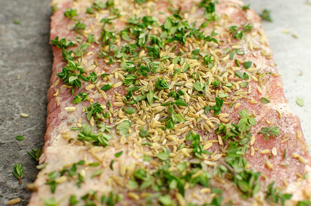 Fennel seed and Thyme leaves sprinkled over the pork belly