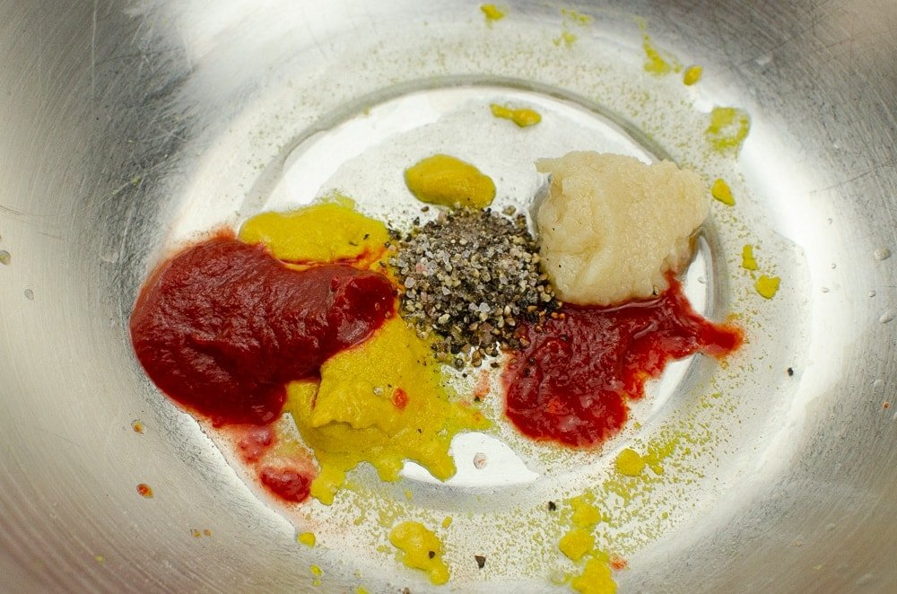 Garlic puree ,English mustard,chilli puree,black pepper and salt in a silver mixing bowl