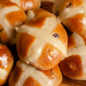 Flawless Hot Cross Buns on a wooden board