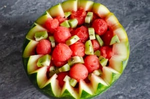 Watermelon balls and cut up kiwi in a Watermelon Ball bowl ready to be served