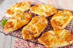 Flawless cheese and bacon turnovers cooling off on a wire rack