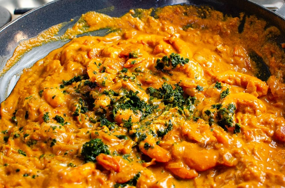 King Prawns cooked in a Masala Sauce with coriander added on top.