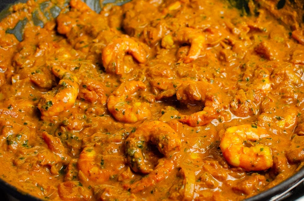 Juicy King Prawns cooked in Masala Curry Sauce in a cast iron dish