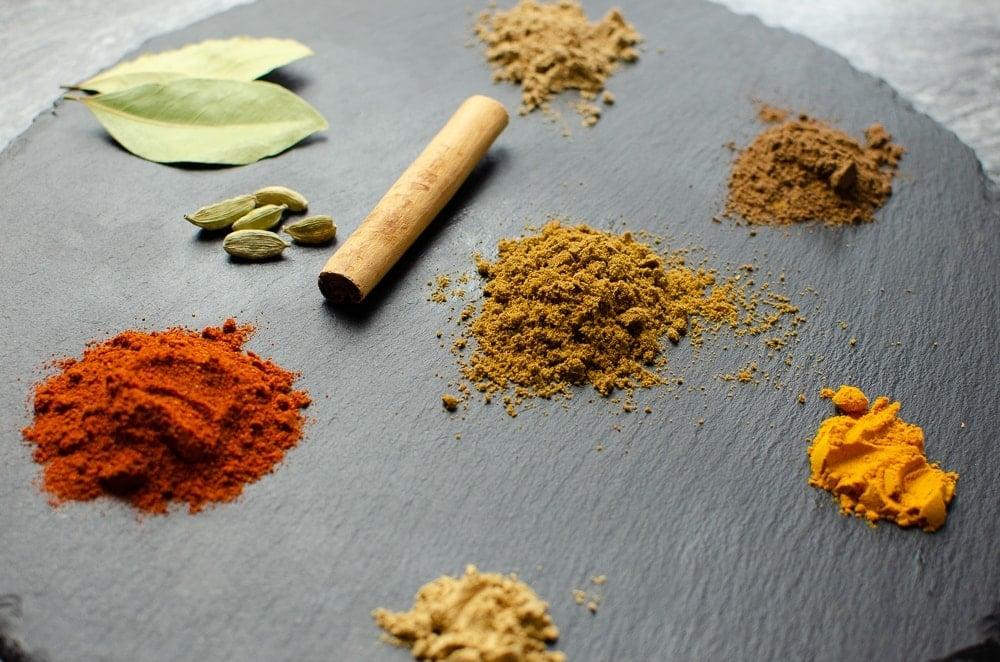 mix of paprika, cumin, allspice, ginger, turmeric and coriander. Plus a cinnamon stick & cardamom pods