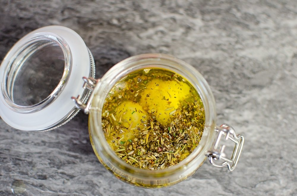 Crushed garlic has been added to our Mediterranean salad dressing in a glass pot