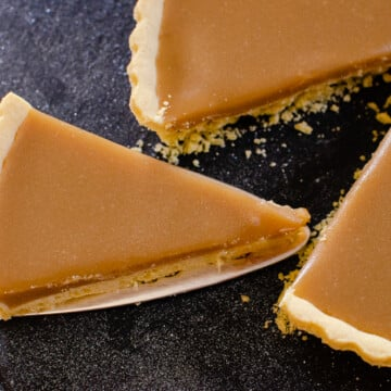 slice of butterscotch tart being lifted up to serve