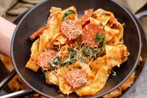 Chorizo and Tomato Pappardelle Pasta served in a black bowl