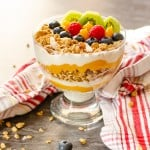 Tropical Granola Breakfast in a glass bowl with red and white striped towel