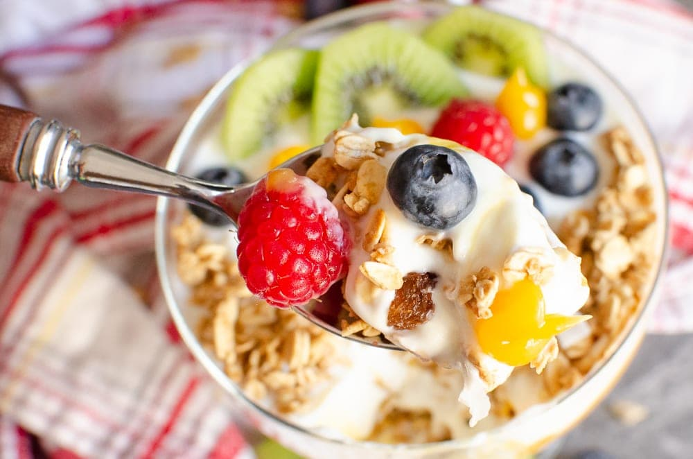 Tropical Granola Yoghurt with Fruit on a spoon ready to eat
