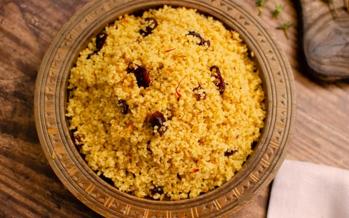 Persian Saffron Couscous in a brown bowl