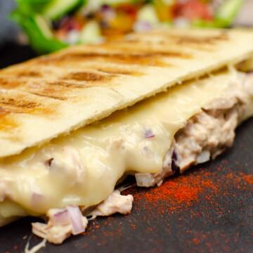 Tuna and Cheese Melt Panini on black slate