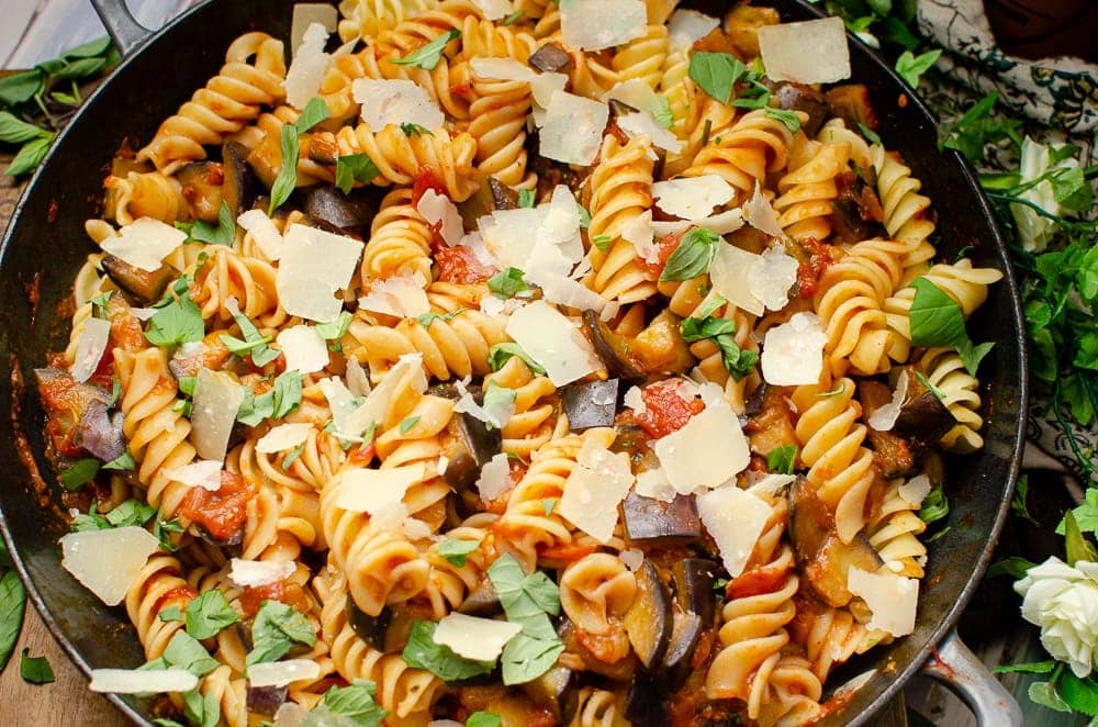 Flakes of Parmesan sprinkled over the aubergine pasta dish