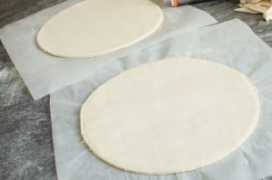 Circle shapes of puff pastry x2 on parchment paper
