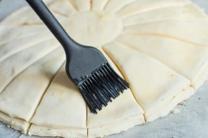 Brushing the puff pastry with egg with a black brush
